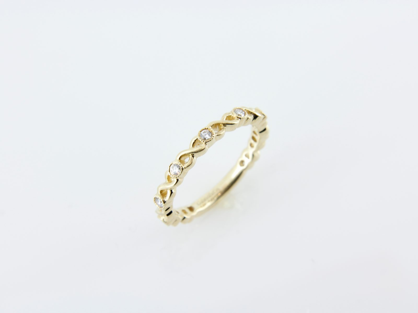 infinity yellow gold stacker band forge jewelry